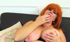 English milf Ginger Tiger fingers her wet fanny