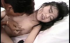 Asian teen Nicoline with small titties