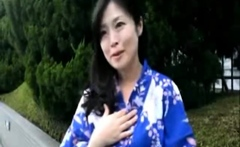 Wild japanese brunette plays with two cocks