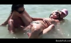 Lesbian amateur trio working pussies in the sea
