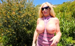 Blonde big titted MILF flashing pussy and ass outdoor