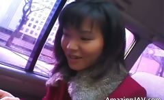 Hot asian babe in car having fun