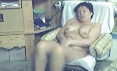 My 48 years latina Mom fingering in living room