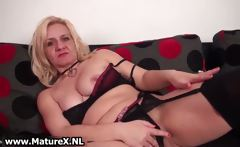 Old blond lays down on the sofa
